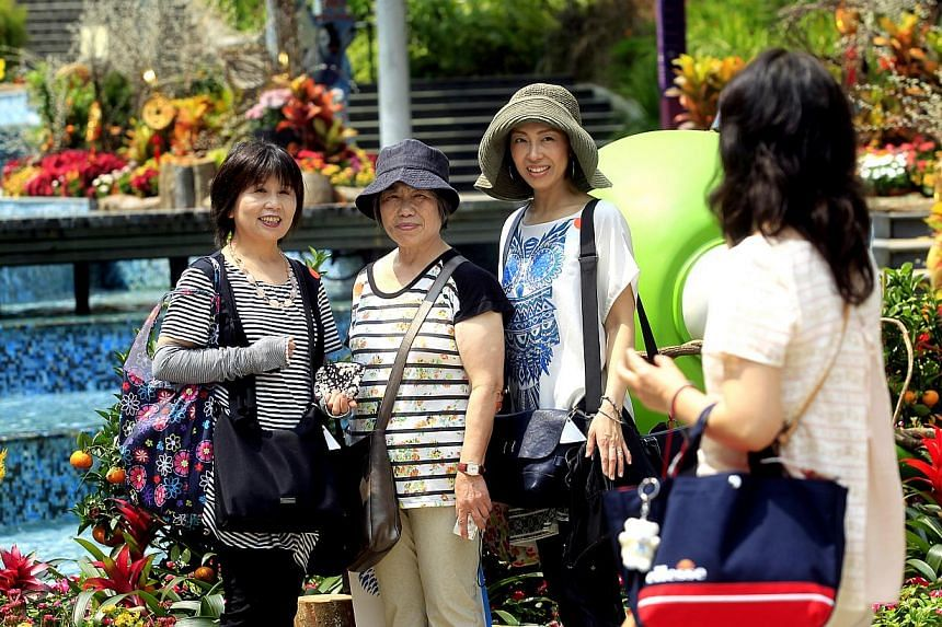 Japanese tourists at the Imbiah Station at Sentosa, which is the place that many of them associate with Singapore. STB figures show that Japan is the sixth-biggest source of tourists for Singapore. -- ST PHOTOS: CHEW SENG KIM