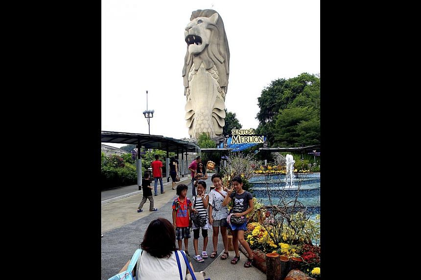 Above and right: Japanese tourists at the Imbiah Station at Sentosa, which is the place that many of them associate with Singapore. STB figures show that Japan is the sixth-biggest source of tourists for Singapore.