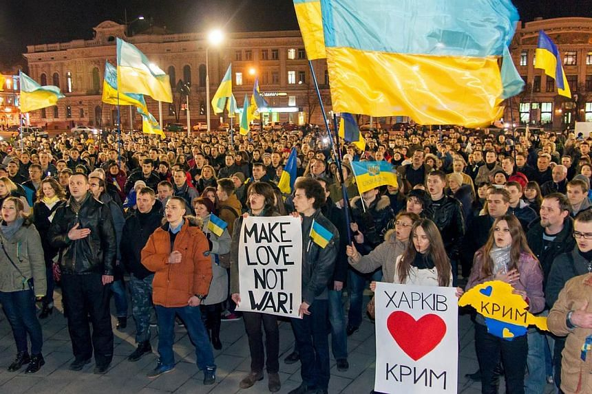 Pro-Ukrainian activists sing the state anthem during q rally in the center of the eastern Ukrainian city of Kharkiv on March 6, 2014, as they protest against Russian aggression in Crimea. -- PHOTO: AFP