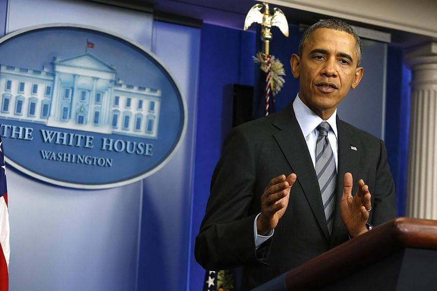 US President Barack Obama delivers a statement on the situation in Ukraine in the press briefing room at the White House in Washington on March 6, 2014. -- PHOTO: REUTERS