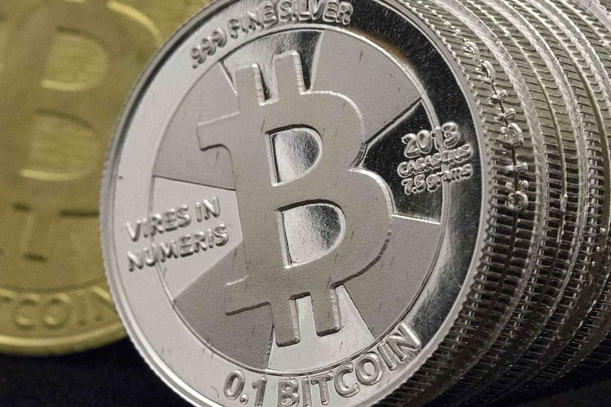A photo illustration of coins from a Bitcoin collection. -- FILE PHOTO: REUTERS