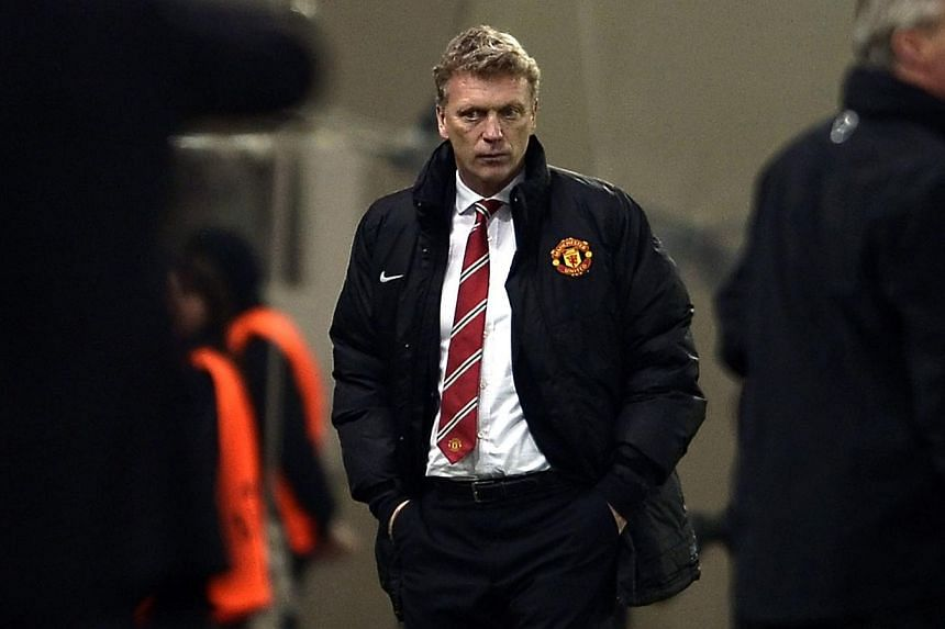 Manchester United's Scottish manager David Moyes looks on during the round of 16 Champions League football match Olympiakos vs Manchester United at Karaiskaki Stadium in Athens on Feb 25, 2014. -- FILE PHOTO: AFP