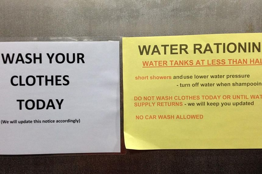 Stern orders like these are put up at some residential apartments in Kuala Lumpur to remind residents to save water, as the country suffers a prolonged dry spell. -- PHOTO: CAROLYN HONG