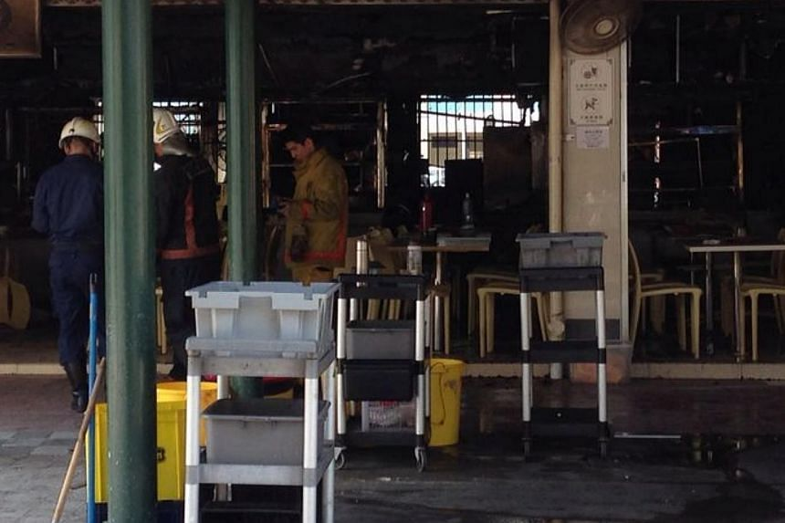 SCDF at the coffee shop in Block 59 Marine Terrace where a fire broke out in the morning. -- ST PHOTO: JAMIE KOH