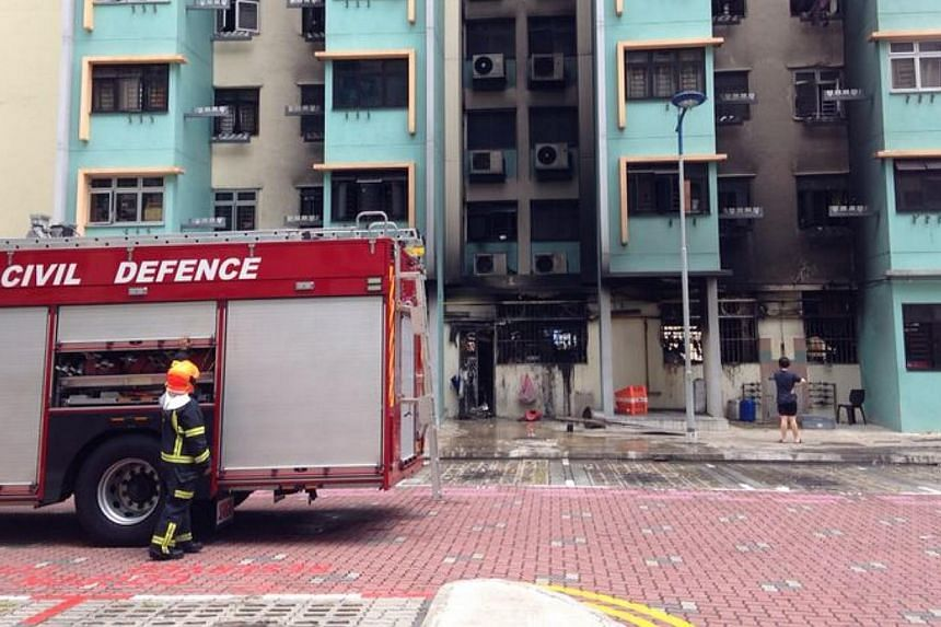 Blackened windows and air con units at the back of the coffee shop at Block 59 Marine Terrace where a fire broke out. -- ST PHOTO: JAMIE KOH