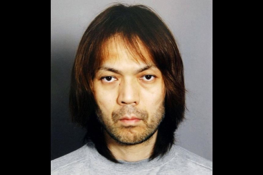 A former member of the Aum Supreme Truth was sentenced to nine years in prison for abduction on Friday, March 7, 2014, 19 years after the doomsday cult launched a nerve gas attack on the Tokyo subway, court officials said.-- FILE PHOTO: A