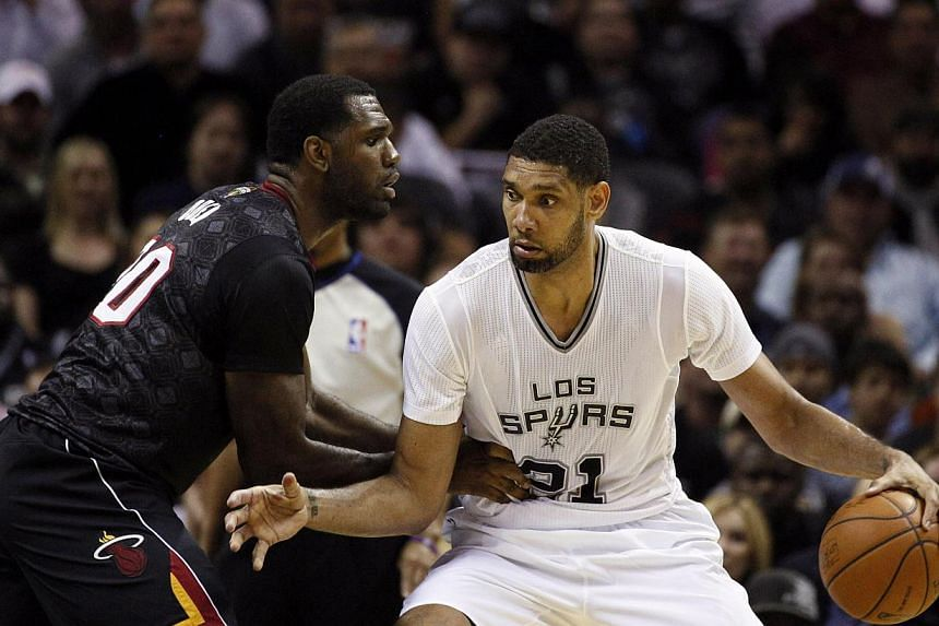 San Antonio Spurs forward Tim Duncan (No. 21) is defended by Miami Heat centre Greg Oden (No. 20) during the first half at AT&T Centre. Tim Duncan tallied 23 points and 11 rebounds to power the San Antonio Spurs to a 111-87 victory over the Miami