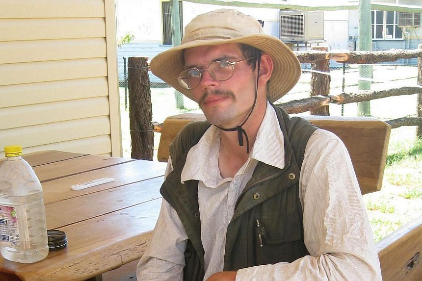 German tourist Daniel Dudzisz taking a break during his trek around Australia, onJan 14, 2014.Stranded by floods and lost, a German backpacker survived for about two weeks in Australia's inhospitable outback on a diet of insects, police s