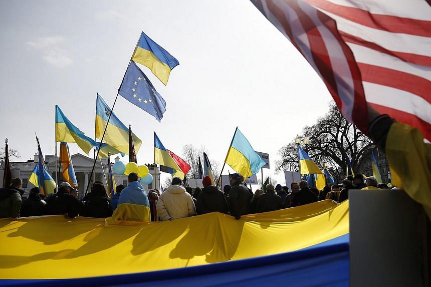 Demonstrators call on the United States to take measures against Russia's recent actions in Ukraine, in front of the White House in Washington on March 6, 2014. -- PHOTO: REUTERS