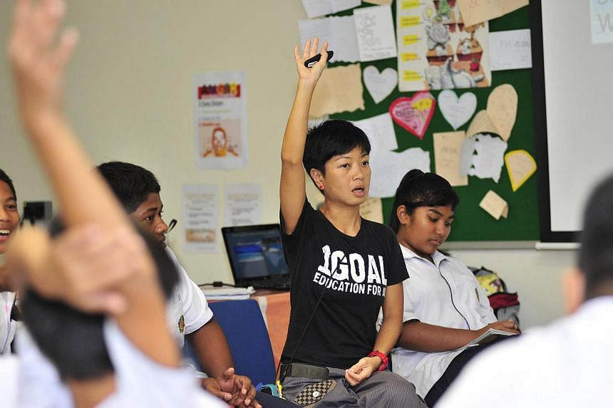 A teacher conducts an English lesson at Assumption Pathway School.The setting up of specialised schools that recruit students who have failed the Primary School Leaving Examinations (PSLE) have lowered the student attrition rate, Education Mini