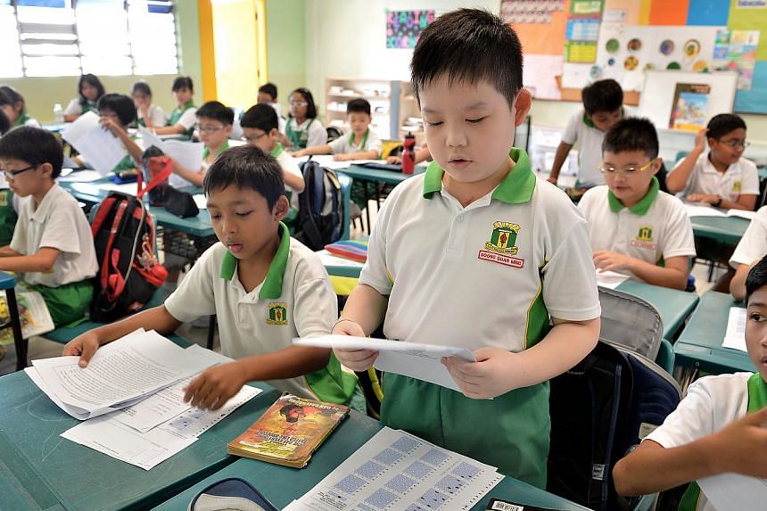 A Primary 4 pupil at Bukit Panjang Primary School reading aloud in class, after being on a support programme for pupils with dyslexia. The Ministry of Education will extend help for pupils with dyslexia to another 20 primary schools this year, b