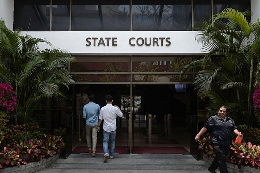 People enter and exit the newly-named State Courts on March 7, 2014. -- ST PHOTO: MARK CHEONG