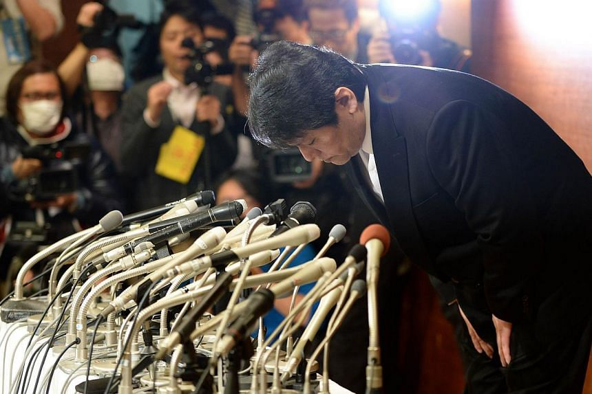 "Mamoru Samuragochi, dubbed ""Japan's Beethoven"", bows in apology at a press conference room in Tokyo on March 7, 2014. Samuragochi said on Friday that tests had shown he was not legally deaf and apologised to people throughout the country fo"
