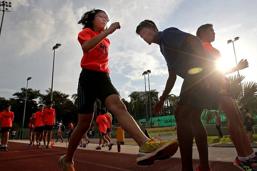 A primary school pupil trains with a coach, part of a growing trend as parents push their children to excel in sports so that they can enrol in a school through the Direct School Admission (DSA) programme.-- TNP FILE PHOTO:GAVIN FOO
