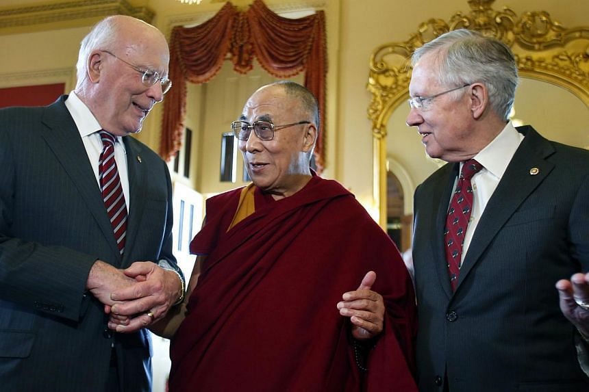 U.S. Senate Majority Leader Harry Reid (D-NV) (right) and Patrick Leahy (D-VT) greet the Dalai Lama before his meeting with Senate leadership on Capitol Hill in Washington, March 6, 2014. China expressed anger on Friday over the Dalai Lama's mee