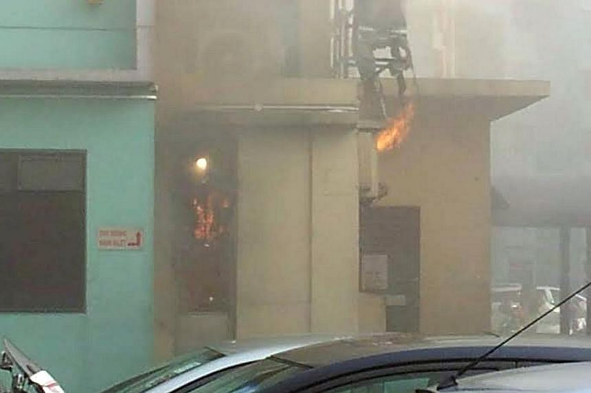Fire engulfed a coffee shop at Block 59 Marine Terrace on Friday morning. -- PHOTO: STOMP