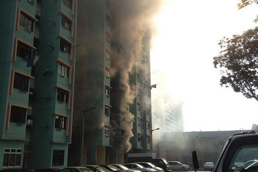 Fire engulfed a coffee shop at Block 59 Marine Terrace on Friday morning. --PHOTO: STOMP