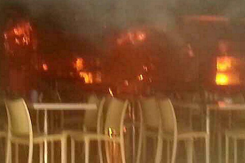 Fire engulfed a coffee shop at Block 59 Marine Terrace on Friday morning. --PHOTO:COURTESY OF MADAM KU LIE JAU