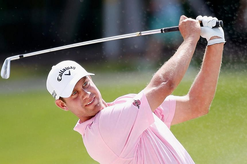 American Harris English grabbed the clubhouse lead while world No. 1 Tiger Woods struggled on Thursday, March 6, 2014, until darkness halted the first round of the storm-hit WGC-Cadillac Championship. -- PHOTO: AFP