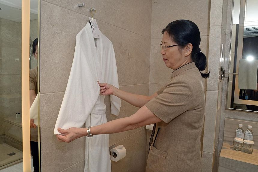 Older workers, like Madam Loo Jee Jong who works at Marriott Hotel as a housekeeper, may soon be able to work until they turn 67. -- ST FILE PHOTO: DESMOND WEE