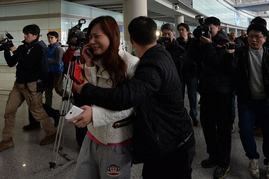 A possible relative cries at the Beijing Airport after news of the missing Malaysia Airlines Boeing 777-200 plane in Beijing on March 8, 2014. -- PHOTO: AFP
