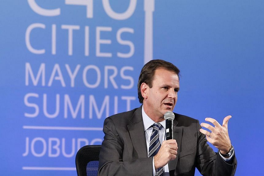 Rio's mayor and C40 chairman Eduardo Paes takes part in a debate on the first day of the C40 Cities climate summit in Johannesburg on Feb 5, 2014. Mr Paes said he would fine himself after being caught on video appearing to be dropping trash in the st