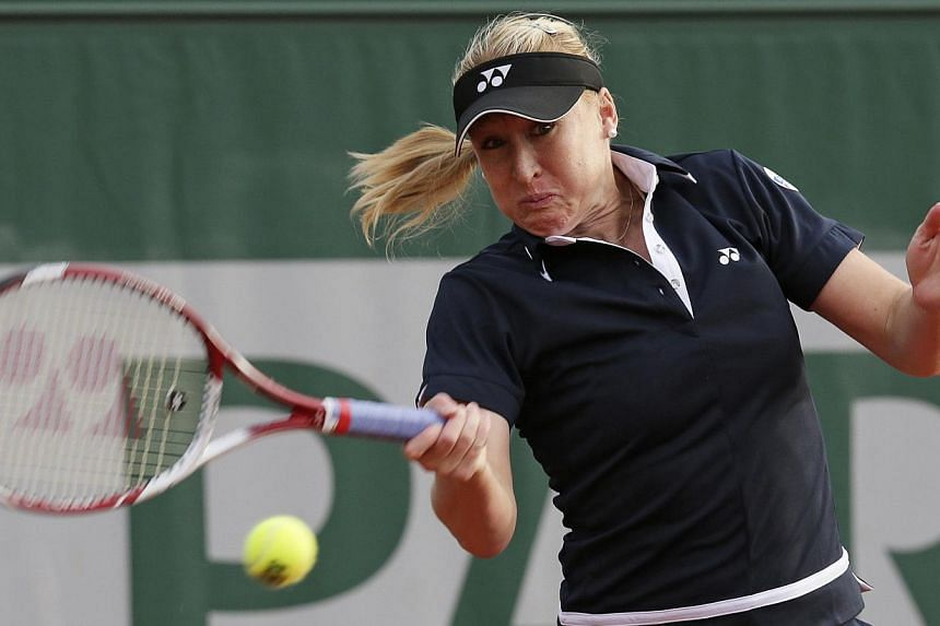 Elena Baltacha of Britain hitting a return to Marina Erakovic of New Zealand during their women's singles match at the French Open tennis tournament at the Roland Garros stadium in Paris on May 28, 2013. Former British number one Elena Baltacha revea