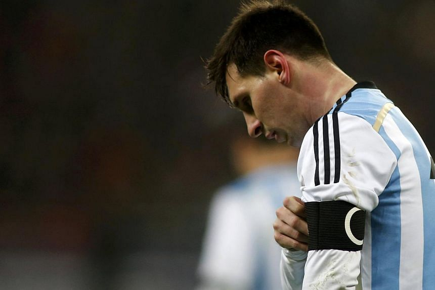 Argentina's Lionel Messi leaves the field at half time during their international friendly soccer match against Romania at the National Arena in Bucharest on March 5, 2014. Barcelona coach Gerardo Martino has voiced his concern for Messi after the Ar