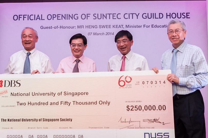 (From left) NUSS President David Ho, Education Minister Heng Swee Keat, NUS Alumni Bursary Fund Chairman and NUSS Immediate Past President Johnny Tan, and NUS Board of Trustees Chairman Wong Ngit Liong, holding up a cheque of $250,000, which NUSS don