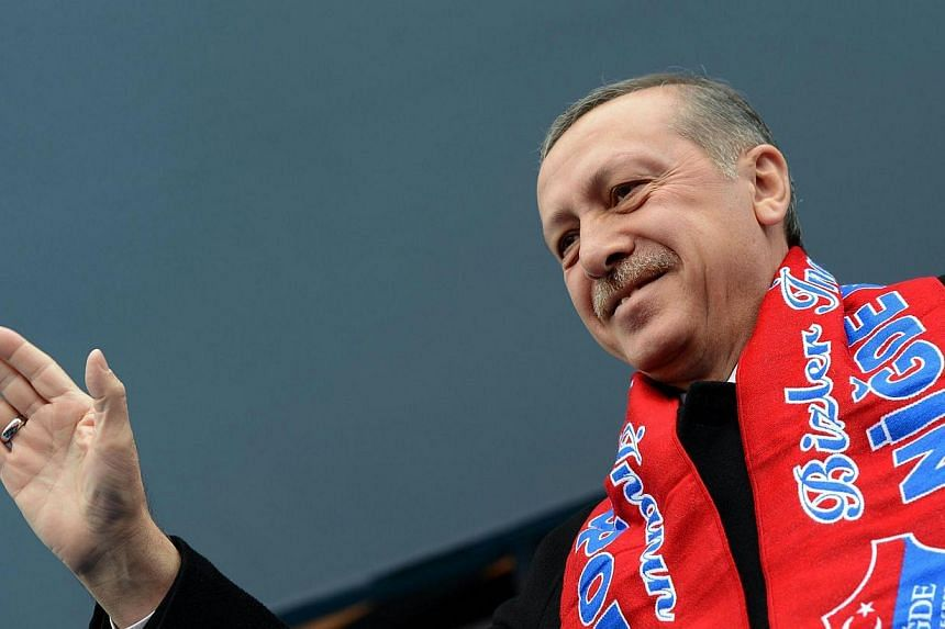 This picture released by the Turkish Prime Minister's office shows Turkish Prime Minister Recep Tayyip Erdogan addressing a rally of his Justice and Development Party (AKP) in Nigde on March 3, 2014. -- FILE PHOTO: AFP