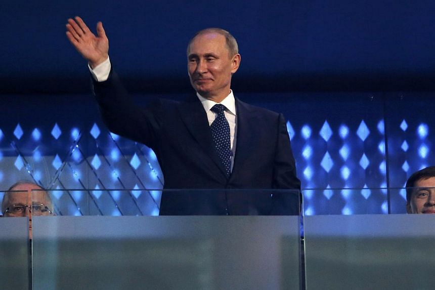 Russia's President Vladimir Putin attends the opening ceremony of the 2014 Paralympic Winter Games in Sochi on March 7, 2014. A Pentagon research team is studying the body language of Russian President Vladimir Putin and other foreign leaders t