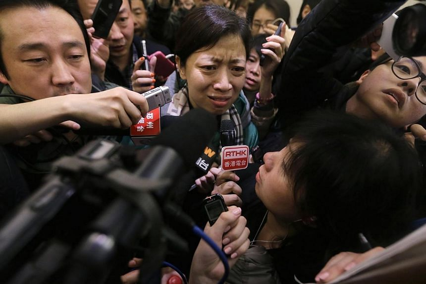 A woman, whose husband is a passenger on Malaysia Airlines flight MH370 leaves a hotel in Beijing, March 8, 2014. -- PHOTO: REUTERS