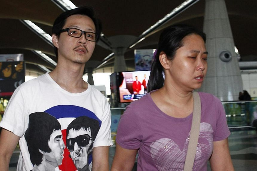 Family members of those onboard the missing Malaysia Airlines flight walk into the waiting area at Kuala Lumpur International Airport in Sepang, March 8, 2014. -- PHOTO: REUTERS
