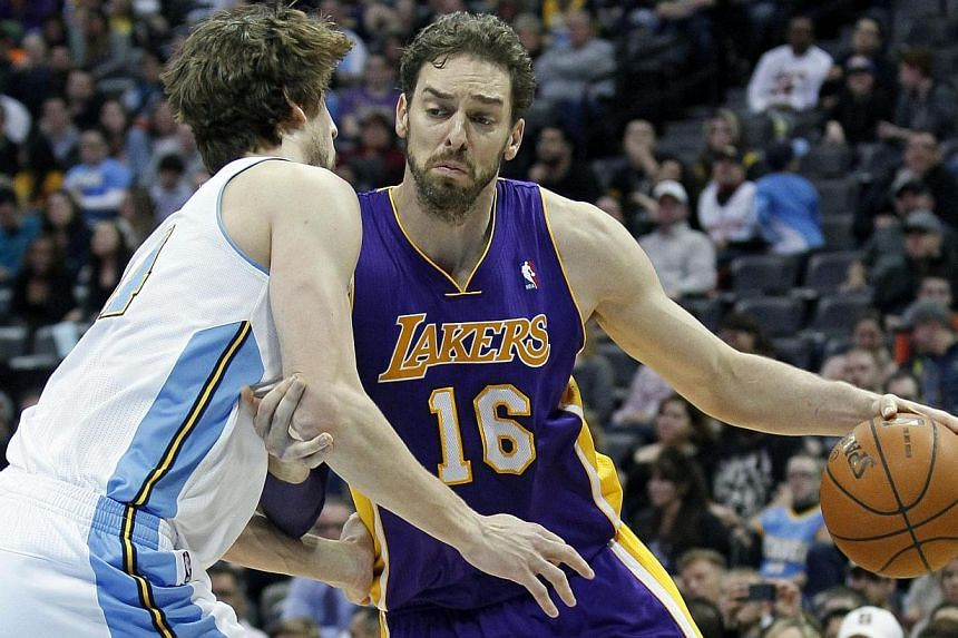 Denver Nuggets power forward Jan Vesely (left) guards Los Angeles Lakers center Pau Gasol in the fourth quarter at the Pepsi Center.The Denver Nuggets took their head coach Brian Shaw's advice and tried to run up the score against the hapless L