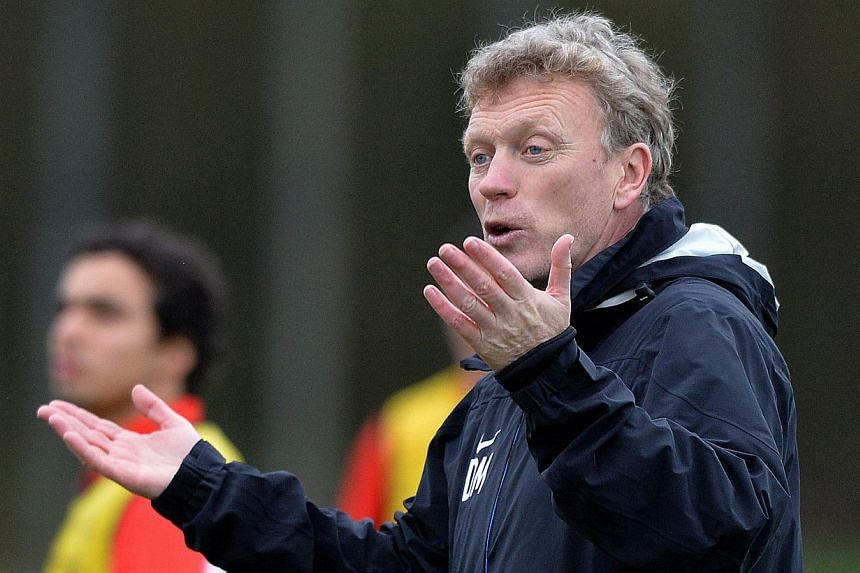 In his candid quarterly address to Manchester United fans in the club's magazine, manager David Moyes wrote that he had not expected the job of succeeding Alex Ferguson to be quite as difficult as this EPL season has proven. -- FILE PHOTO: AFP