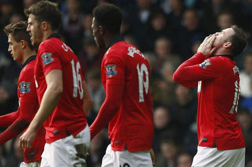 Manchester United's Wayne Rooney (right) celebrates after scoring a goal against West Bromwich Albion at The Hawthorns on March 8, 2014. United kept their faltering push for a Champions League place alive with a breezy 3-0 victory at West Brom in the