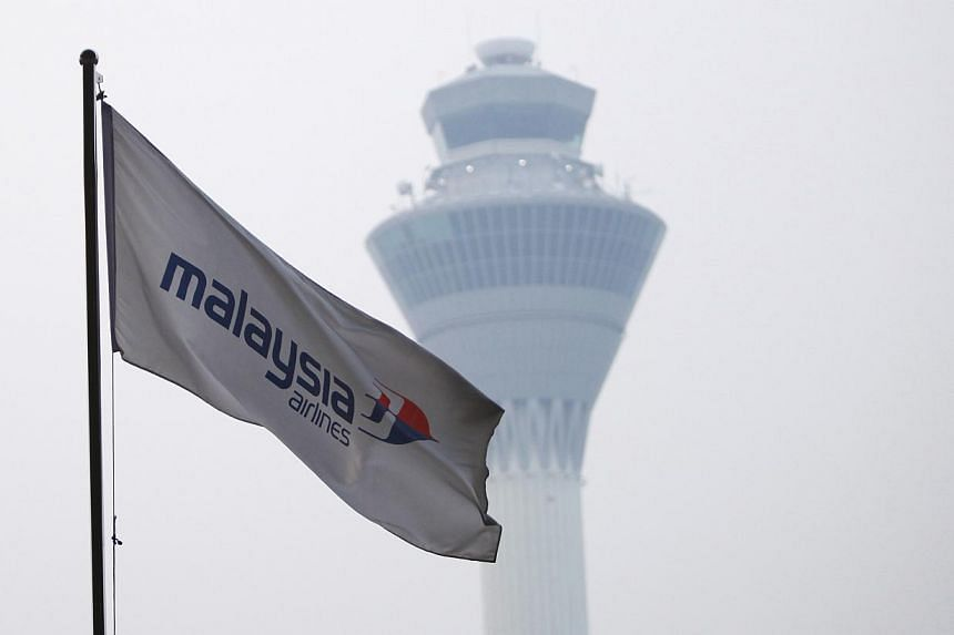 A Malaysia Airlines flag is seen at Kuala Lumpur International Airport in Sepang, on March 8, 2014. -- PHOTO: REUTERS