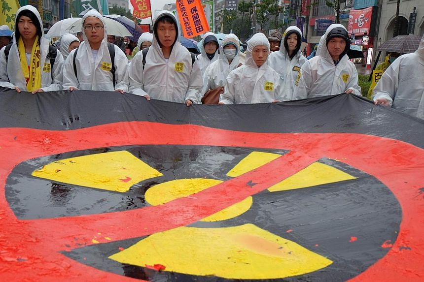 Protesters take part in an anti-nuclear demonstration in Taipei on March 8, 2014. Tens of thousands marched in Taiwan Saturday to call for an end to nuclear energy on the island, ahead of the third anniversary of the Fukushima atomic disaster in Japa