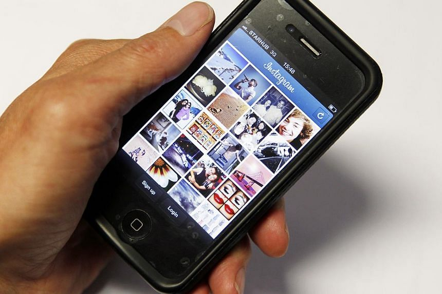 Facebook-owned photo sharing service Instagram on Friday said it has landed its first deal with a major ad agency. -- ST FILE PHOTO:LIM WUI LIANG