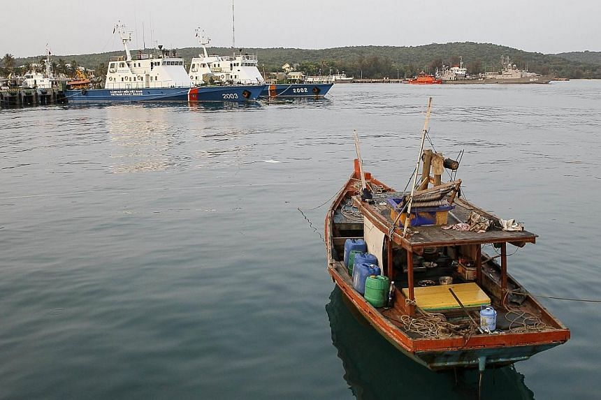A fishing boat is anchored near a local naval base at Phu Quoc island, in the waters of southern Vietnam, where a Malaysian Airlines jet was presumed lost on March 8, 2014. An Austrian reported to have been aboard the Malaysia Airlines plane missing