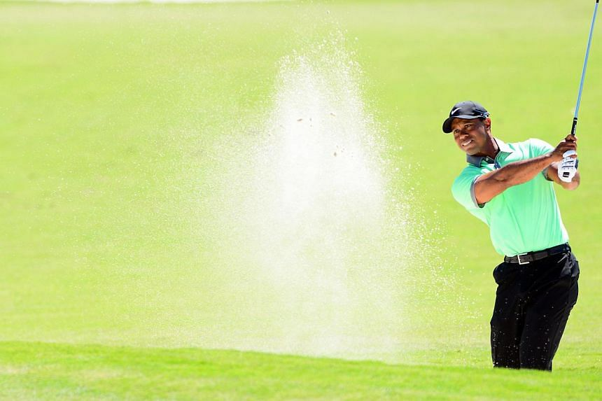 Tiger Woods stormed into contention at the WGC-Cadillac Championship on March 8, 2014, shooting a six-under-par 66 to grab the early clubhouse lead midway through the third round. -- PHOTO: REUTERS