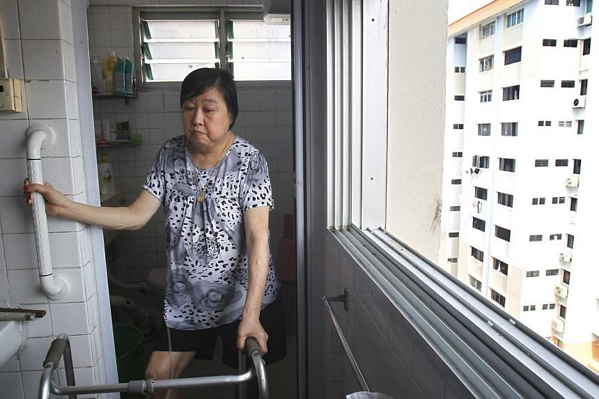 The HDB installed eight grab bars and applied slip-resistant chemical treatment in one bathroom in Madam Eng Bok Hua's four-room flat. The total cost was around $750 but she needed to pay only $56.20.