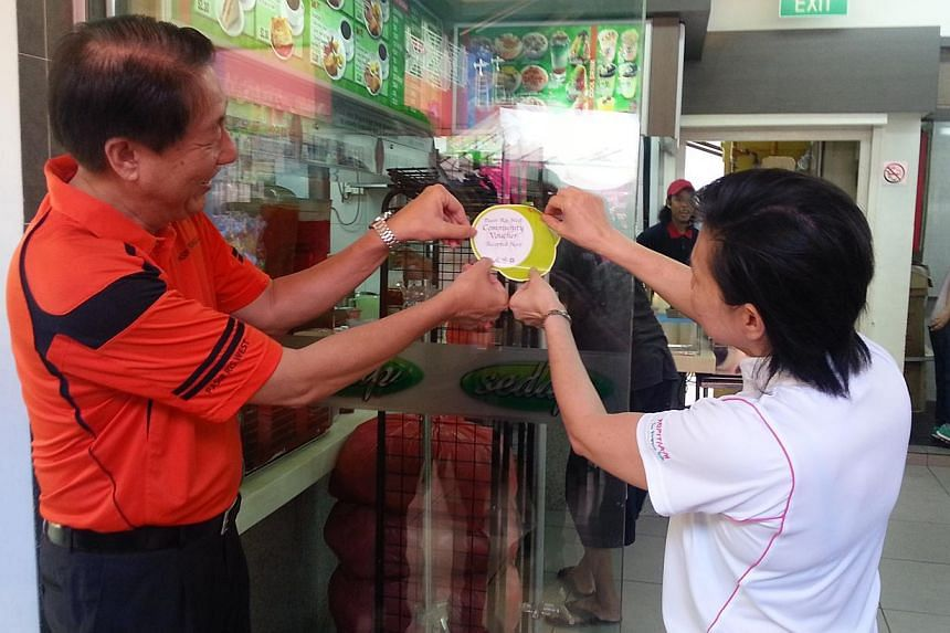 Deputy Prime Minister and MP for Pasir Ris-Punggol GRC Teo Chee Hean launched the North East Community Vouchers@Pasir Ris West at Pasir Ris West Plaza on March 9, 2014. -- ST PHOTO: AUDREY TAN