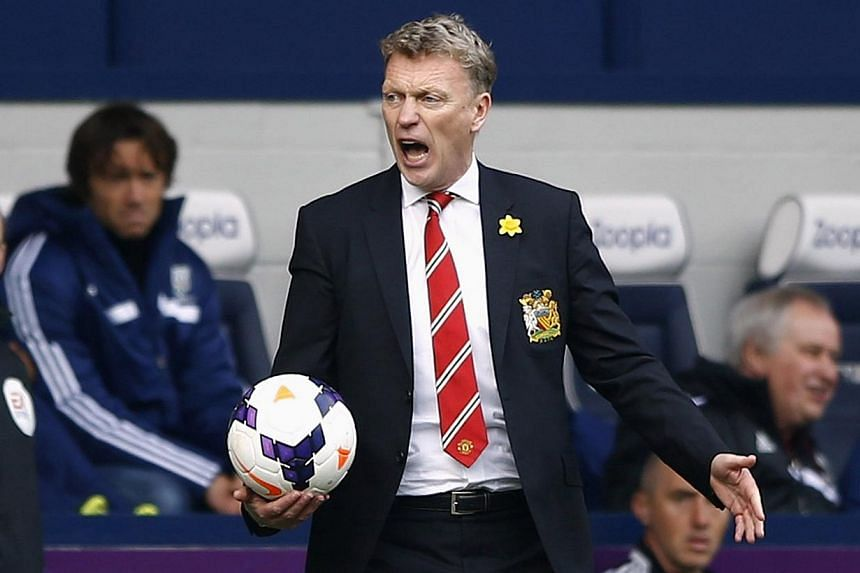 Manchester United manager David Moyes reacts during their English Premier League soccer match against West Bromwich Albion at The Hawthorns in West Bromwich, central England, on March 8, 2014. -- PHOTO: REUTERS