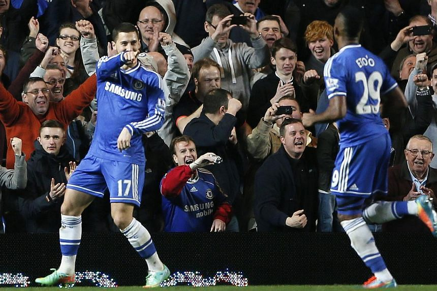 Chelsea's Eden Hazard (left) and team mate Samuel Eto'o celebrate Hazard's penalty goal against Tottenham Hotspur during their English Premier League soccer match at Stamford Bridge in London on March 8, 2014. -- PHOTO: REUTERS