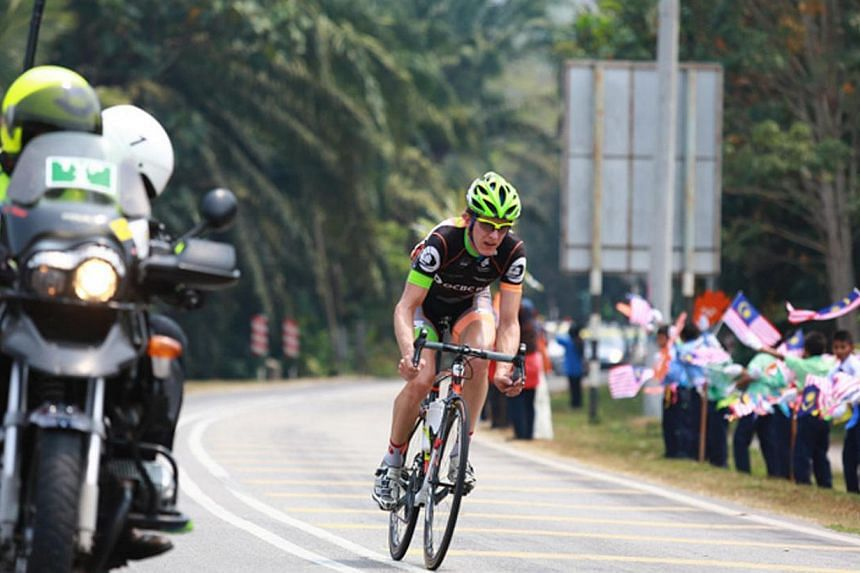 OCBC Singapore Pro Cycling Team rider Thomas Rabou leads a breakaway during Stage 5 of Le Tour de Langkawi on Monday, March 3, 2014, in Rembau, Malaysia.OCBC Singapore Pro Cycling Team captain Thomas Rabou has won the the Criterium Internationa