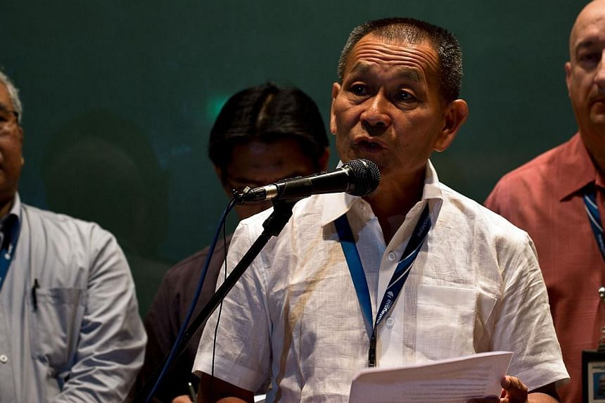 Malaysian Airlines Group chief executive Ahmad Jauhari Yahya addresses the media near Kuala Lumpur International Airport on March 8, 2014. More than 24 hours after a Malaysia Airlines plane went missing, stories of Chinese nationals on board flight M