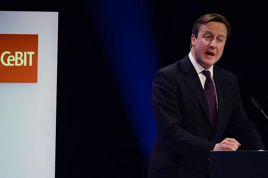 British Prime Minister David Cameron delivers a speech at the opening ceremony of the 2014 CeBIT technology trade fair on March 9, 2014 in Hanover, central Germany. -- PHOTO: AFP
