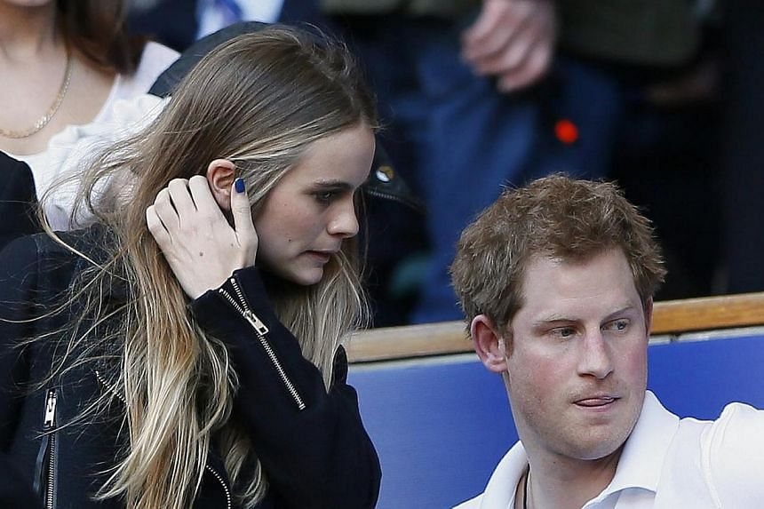 Britain's Prince Harry and Miss Cressida Bonas attend England's Six Nations international rugby union match against Wales at Twickenham in London March 9, 2014. Britain's Prince Harry and his long-term girlfriend Cressida Bonas have finally made