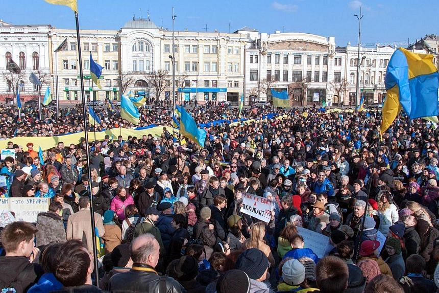 Pro-Ukrainian supporters attend a rally in Kharkiv, northeastern Ukraine, on March 9, 2014. Ukraine sought urgent Western backing on Monday after Russian President Vladimir Putin insisted that Crimea had the right to join his country even while hinti